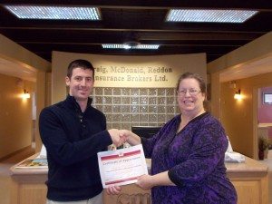 Photo of Craig, McDonald, Redden Insurance Brokers Ltd. receiving a certificate of appreciation from the Literacy Council